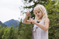 Girl holding a selfmade bow outdoors - TCF05797
