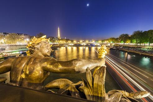 France, Paris, Eiffel Tower, View from Pont Alexandre III bridge, Seine river, bronze sculpture at blue hour - WDF04804