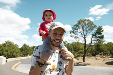 USA, Arizona, Grand Canyon National Park, father and baby girl carrying on shoulders - GEMF02355