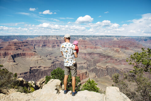 USA, Arizona, Grand Canyon National Park, father and baby girl enjoying the view, rear view - GEMF02358