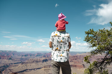 USA, Arizona, Grand Canyon National Park, father and baby girl enjoying the view, carrying on shoulders, rear view - GEMF02364