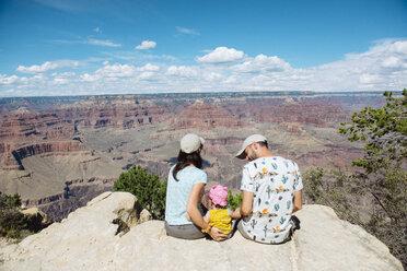 USA, Arizona, Grand Canyon National Park, South Rim, Family sitting on viewpoint - GEMF02367