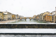 Italy, Florence, view to Ponte Vecchio on a snowy day - MGIF00220