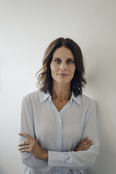 Portrait of an attractive businesswoman with arms crossed - KNSF04519