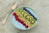Smoothie bowl with blueberries, raspberries, kiwi and chopped hazelnuts - JUNF01096