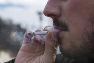 Detail of smoker, cigarette and smoke - JUNF01118