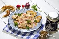 Bavarian veal sausage salad with roasted pretzel rolls, sweet mustard, pretzels, red radish and beer mug - MAEF12724