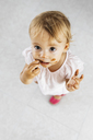 Portrait of little girl eating chocolate cookie - JRFF01811