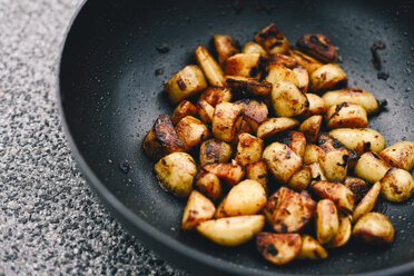 Fried potatoes with smoked paprika in  pan - RAMAF00021