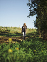 Farmer walking on a field - RAMAF00048
