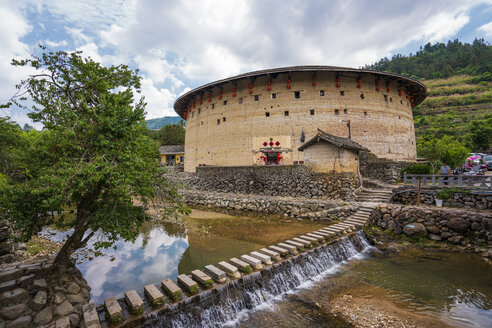 China, Fujian Province, tulou at a weir in a Hakka village - KKAF01497