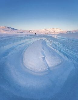 Explorer on shore of Arctic Ocean ice, Arctic Bay, Nunavut, Canada - AURF02449