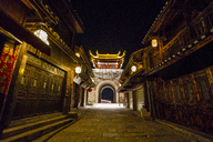 China, Qinyang, Ancient Town, city gate at night - KKAF01519