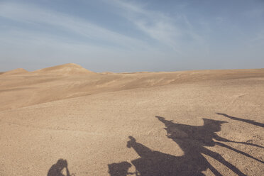 Morocco, Shadows of a caravan with camels and tourists on sand - MMAF00512
