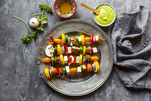 Vegetarian grill skewers, tomato, yellow and green zucchini, tofu, feta, onion and champignon, Argentinian chimichurri - SARF03927