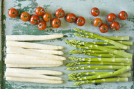 Raw white and green asparagus spears and tomatoes - ASF06224