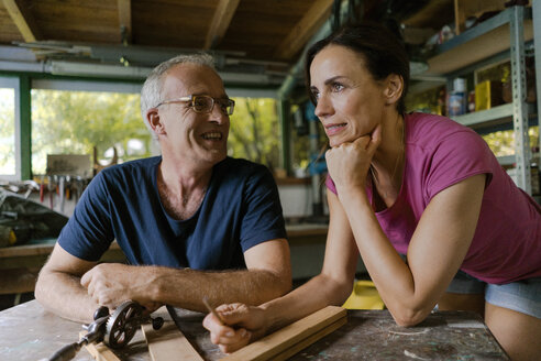 Smiling mature couple in workshop - KNSF04691