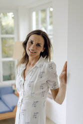 Portrait of smiling mature woman at home - KNSF04754