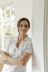 Portrait of smiling mature woman at home - KNSF04757