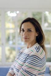 Portrait of confident mature woman at home - KNSF04766