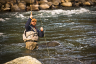 A fly fisherman at work in a river. - AURF02627
