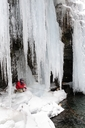 A man fly fishing under icicles on a cold winter day. - AURF02684