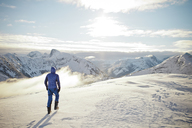 A man explores a winter landscape in British Columbia, Canada. - AURF02699