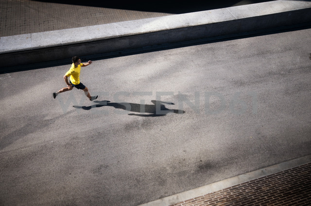 A male running along a path. - AURF02732 - Cavan Images/Westend61