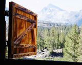 View of the mountains in Yosemite National Park though a open, wooden barn window. California. USA. - AURF02843