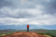 China, Yunnan province, Dongchuan, Red Land, young woman standing on viewpoint - KKAF01537