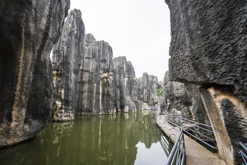 China, Shilin, Stone forest, lake and path - KKAF01543