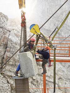 Germany, Bavaria, Garmisch-Partenkirchen, Zugspitze, installers working on goods cable lift - CVF01073