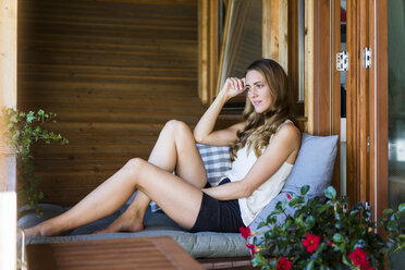 Long-haired woman relaxing on balcony - JOSF02551