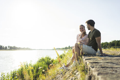 Couple relaxing at the riverside in summer - JOSF02614