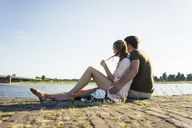 Couple relaxing at the riverside in summer - JOSF02617