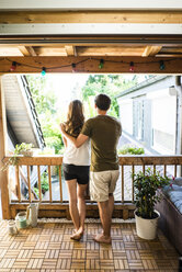 Rear view of couple standing on balcony - JOSF02647