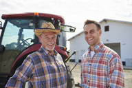 Portrait of two farmers in front of the barn - ABIF00938