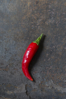 Red Chilli Pepper on rusty metal - JUNF01248