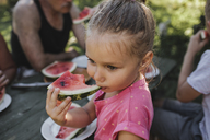 Portrait of little girl eating watermelon - KMKF00481