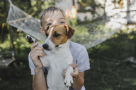 Boy with Jack Russel Terrier in the garden - KMKF00484