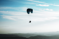 Paragliding, paraglider, blue sky with clouds, mountains - ACPF00315