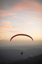 Paraglider flying with mountains in the background during sunset - ACPF00318