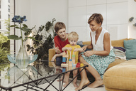 Two mothers learning and playing with their child at home - MFF04432