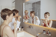 Lesbian couple and their little son getting ready for their day in the bathroom - MFF04447