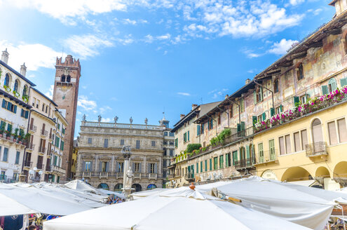 Italy, Verona, view to Piazza delle Erbe with stalls and Torre del Gardello in the background - MHF00468