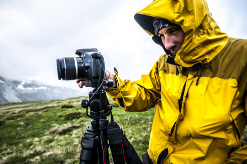 Outdoor photographer shooting on a foggy day in Devero National Park, Ossola, Italy. - AURF03501