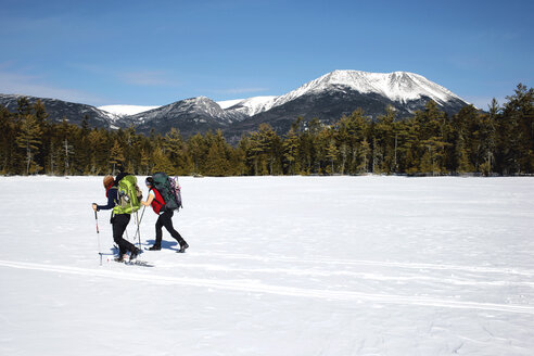 Snowshoers crossing a frozen pond in Baxter State Park. - AURF03549