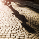Shadow of woman crossing the street - GIOF04272