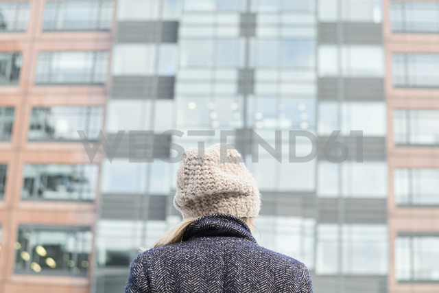 Rear view of a woman wearing wool cap - IGGF00554