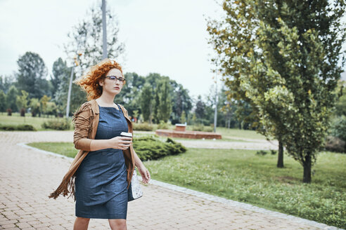 Woman going to work with a take out coffee - ZEDF01503